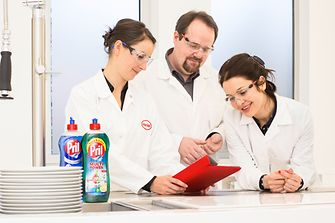 Three employees proving report in lab